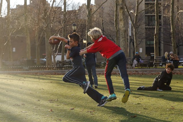 Young boys play in a park during an unusually warm winter day in the Brooklyn borough of New York December 15, 2015. (Photo by Lucas Jackson/Reuters)