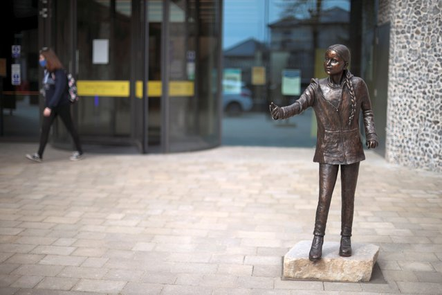 A view of a statue of Swedish climate change activist Greta Thunberg at Winchester University in Winchester, Britain, March 31, 2021. (Photo by Hannah McKay/Reuters)
