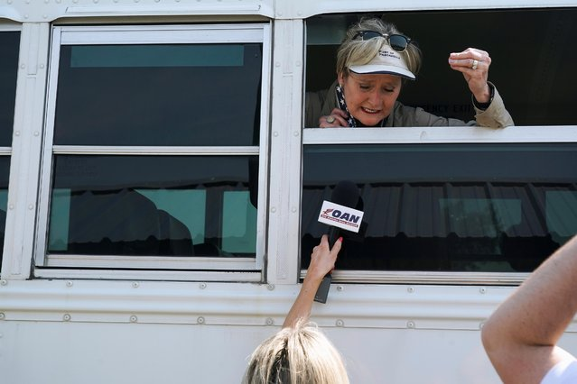 Mississippi Senator Cindy Hyde-Smith speaks to a reporter from a bus window after a tour around a section of the U.S.-Mexico border on a Texas Highway Patrol vessel in Mission, Texas, U.S., March 26, 2021. (Photo by Go Nakamura/Reuters)