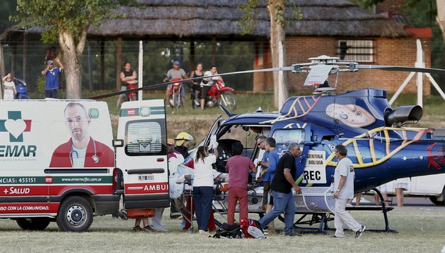 A person that was injured after the Mini driven by Guo Meiling of China went off the road, is taken onto a helicopter during the Buenos Aires-Rosario prologue stage of Dakar Rally 2016 in Arrecifes, Argentina, January 2, 2016. (Photo by Marcos Brindicci/Reuters)