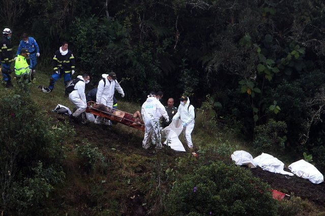 Rescue workers retireve bodies and search for survivors of the plane crash in the municipality of La Union, Department of Antioquia, Colombia, 29 November 2016. According to reports from the Colombian National Police, 75 people died when an aircraft crashed late 28 November 2016 with 81 people on board, including players of the Brazilian soccer club Chapecoense. The plane crashed in a mountainous area outside Medellin, Colombia as it was approaching the Jose Maria Cordoba airport. The cause of the incident is as yet uknown. Chapecoense were scheduled to play in the Copa Sudamericana final against Medellin's Atletico Nacional on 30 November 2016. (Photo by Luis Eduardo Noriega A./EPA)