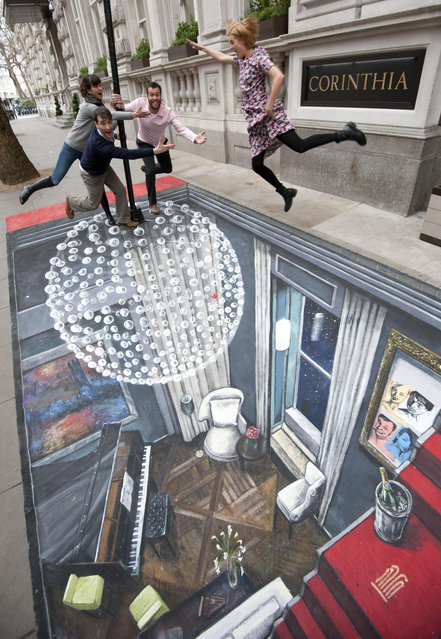 Cast of The Leisure Society, (left to right) Melanie Gray, Ed Stoppard John Schwab and Agyness Deyn pose outside the Corinthia Hotel London on a piece of 3D Street Art created by Joe Hill, who holds the Guinness Book Of Records for the largest 3-D street art and is the showâÄôs Producer. (Photo by Lewis Whyld/PA Images via Getty Images)