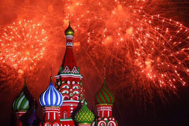 "In this Tuesday, September 3, 2013 photo, fireworks explode in the sky over St. Basil Cathedral during the ""Spasskaya Tower"" International Military Orchestra Music Festival at the Red Square in Moscow, Russia. The festival started on Sunday, September 1 in Moscow and would last until Sunday, September 8. (Photo by Denis Tyrin/AP Photo)"