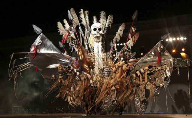 "Fareid Carvalho portraying ""Death Desolation Despair-Keeper Of Souls"" performs at the King of Carnival show put on by the National Carnival Commission at the Queen's Park Savannah, Port-of-Spain, on February 13, 2015. (Photo by Andrea De Silva/Reuters)"