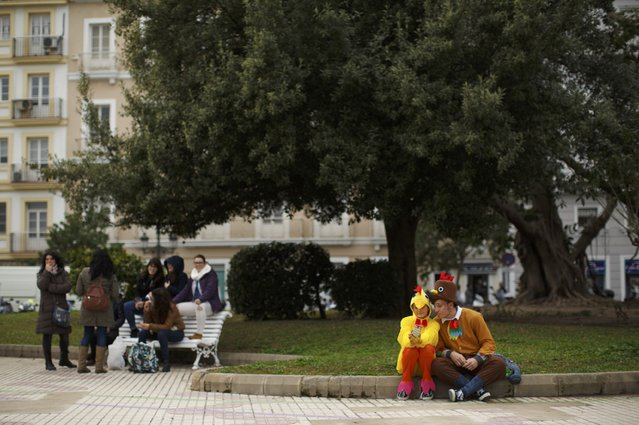 A couple in fancy costumes sit during the Carnival of Cadiz, southern Spain February 15, 2015. (Photo by Marcelo del Pozo/Reuters)