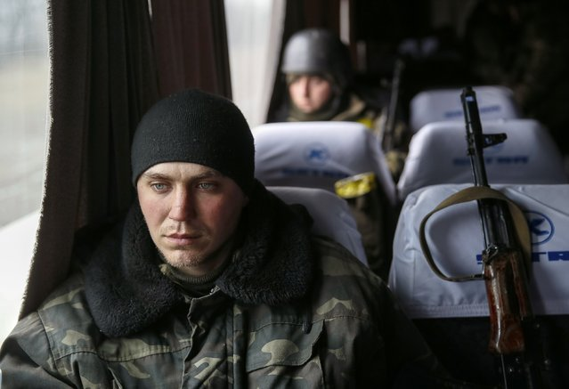 Ukrainian servicemen who fought in Debaltseve are seen in a bus before leaving for home, near Artemivsk February 19, 2015. (Photo by Gleb Garanich/Reuters)