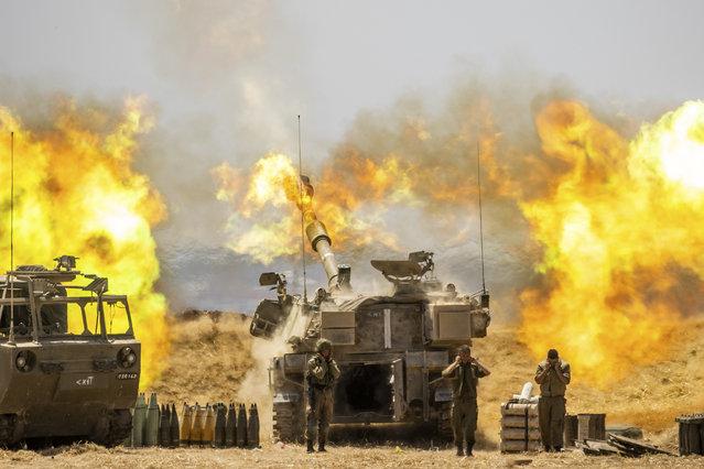An Israeli artillery unit fires toward targets in Gaza Strip, at the Israeli Gaza border, Wednesday, May 12, 2021. (Photo by Yonatan Sindel/AP Photo)