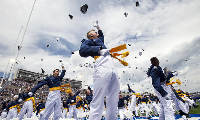 The Air Force Thunderbirds flyover during the celebratory hat toss during the United States Air Force Academy's Class of 2021 graduation ceremony at the USAFA in Colorado Springs, Colo., on Wednesday, May 26, 2021. More than 1,000 cadets celebrated becoming officers. (Photo by Chancey Bush/The Gazette via AP Photo)