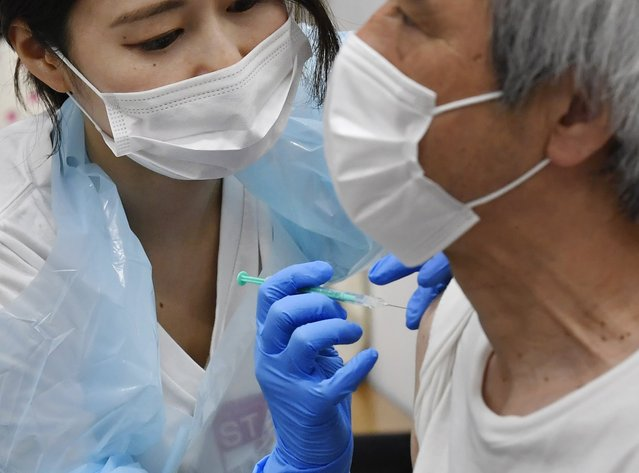 A man receives the Pfizer COVID-19 vaccine at the Noevir Stadium Kobe in Kobe, western Japan, Monday, May 31, 2021. The stadium is being used as an inoculation venue for local residents over 65 years old. Japan, seriously behind in coronavirus vaccination efforts, is scrambling to boost daily shots as the start of the Olympics in July closes in. (Photo by Yu Nakajima/Kyodo News via AP Photo)