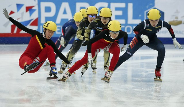 Tao Jiaying of China (L) falls next to her compatriot Han Yutong (C) and Noh Do Hee of South Korea (R) as they compete during the women's 3000m relay final at the ISU World Short Track Speed Skating Championships in Moscow March 15, 2015. (Photo by Grigory Dukor/Reuters)