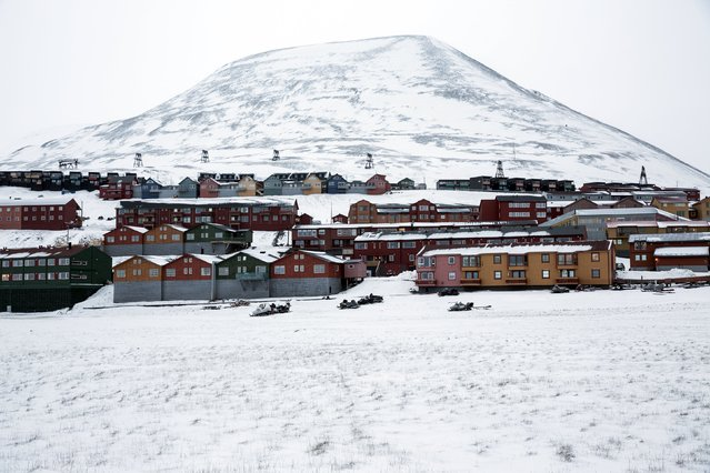 Workers housing of Longyerbyean, Svalbard are seen covered in snow October 23, 2015. (Photo by Anna Filipova/Reuters)