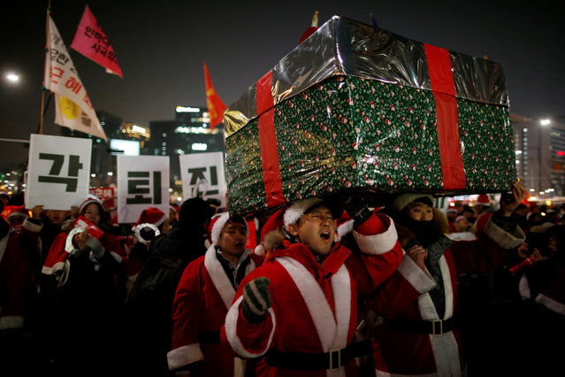 People dressed in Santa's costumes attend a protest demanding South Korean President Park Geun-hye's resignation in Seoul, South Korea, December 24, 2016. (Photo by Kim Hong-Ji/Reuters)