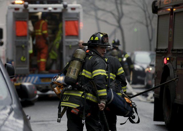 New York City Fire Department firefighters respond to a residential apartment building fire in New York City's East Village neighborhood March 26, 2015. (Photo by Brendan McDermid/Reuters)