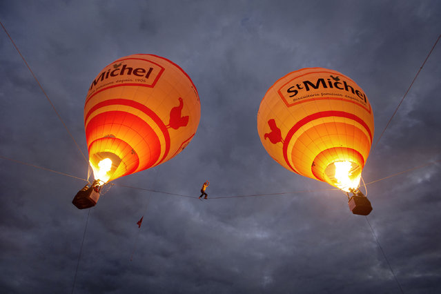 Tancrede Melet walking between two hot air balloon in southern France. (Photo by Chauffour Pierre Productions/Caters News)