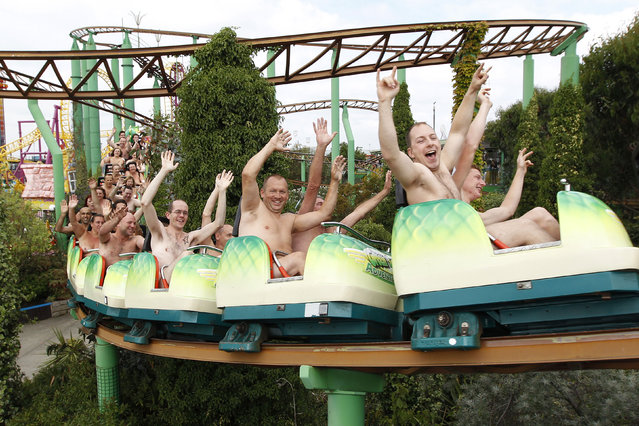 Thrillseekers take part in a world record-breaking nude rollercoaster ride, to raise money for Southend Hospital's breast care unit, at an amusement park in Southend-on-Sea, southeast England August 8, 2010. Participants, who loaded into the carriages 40 at a time, broke the previous world record of 32 naked riders on a theme park ride. A total of 102 riders turned up to ride without clothing. (Photo by Suzanne Plunkett/Reuters)