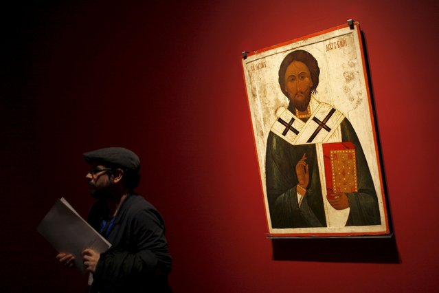 """A man stands next to the icon of """"St. Lazarus the friend of God"""" during an international press tour of the Malaga branch of the State Museum of Russian Art of St Petersburg, a day before its inauguration in Malaga, southern Spain March 24, 2015. (Photo by Jon Nazca/Reuters)"""