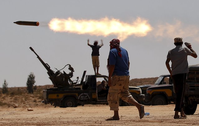 Anti-Gaddafi fighters fire a multiple rocket launcher near Sirte, September 24, 2011. (Photo by Goran Tomasevic/Reuters)