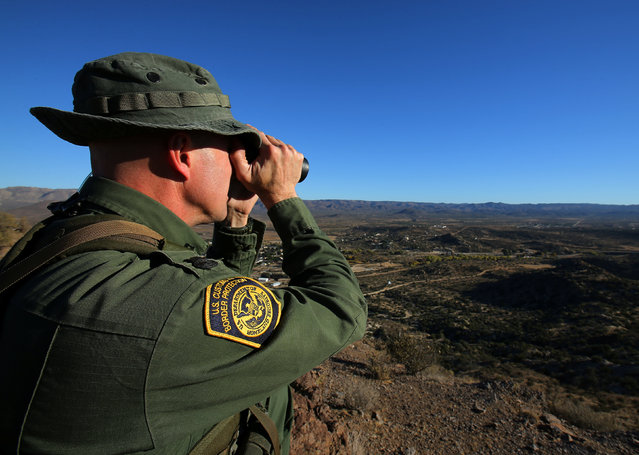 U.S. Border Patrol supervisor Bobby Stine looks out over his station's patrol area atop a hill near Jacumba, California, U.S., November 14, 2016. (Photo by Mike Blake/Reuters)