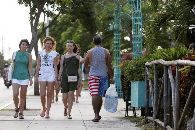 Tourists walk in Varadero, Cuba, December 6, 2018. (Photo by Fernando Medina/Reuters)