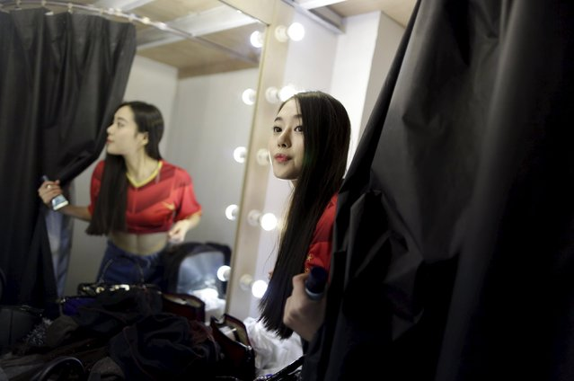 Online hostess Xianggong looks out as she prepares for a football-themed photoshoot at a photography studio in Beijing March 4, 2015. (Photo by Jason Lee/Reuters)