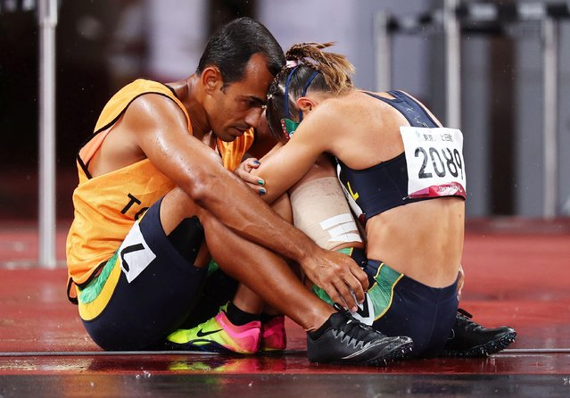 Thalita Vitoria Simplicio da Silva of Brazil reacts with her guide Felipe Veloso da Silva after being disqualified in the women's 100m T11 final during the Tokyo 2020 Paralympics Games at the National Stadium in Tokyo, Japan, Tuesday, August 31, 2021. (Photo by Athit Perawongmetha/Reuters)