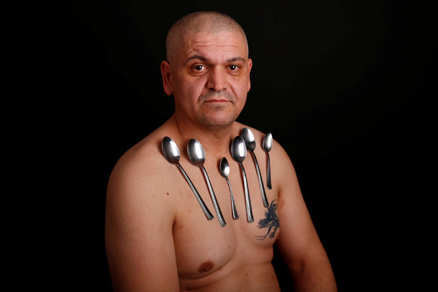 Nermin Halilagic, 38, poses with kitchen utensils in Bihac, Bosnia and Herzegovina, January 23, 2017. (Photo by Dado Ruvic/Reuters)