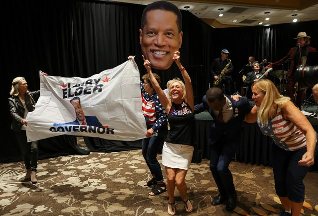 Supporters of Republican gubernatorial candidate Larry Elder react as poll numbers come in on election night at Costa Mesa, California, U.S., September 14, 2021. (Photo by Mike Blake/Reuters)