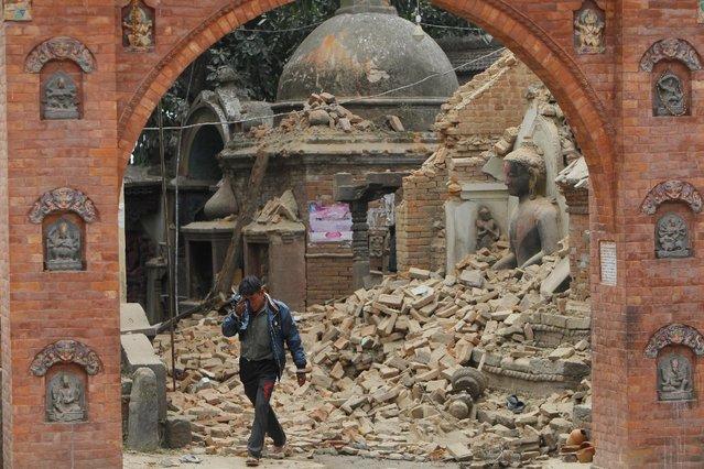 A Nepalese man cries as he walks through the earthquake debris in Bhaktapur, near Kathmandu, Nepal, Sunday, April 26, 2015. (Photo by Niranjan Shrestha/AP Photo)