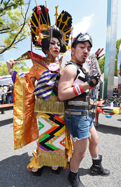Participants of the Tokyo Rainbow Pride 2015 pose for photographers before their parade in Tokyo on April 26, 2015. About 3,000 people took part in the annual gay parade, amid growing calls for more legal protection for the sexual minority. (Photo by Toru Yamanaka/AFP Photo)