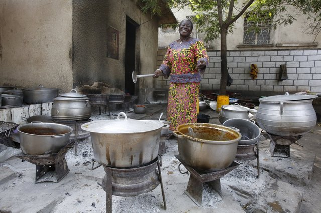 Tata Momo poses for a photograph in the kitchen of the restaurant she owns in Bouake, Ivory Coast February 6, 2016. (Photo by Thierry Gouegnon/Reuters)