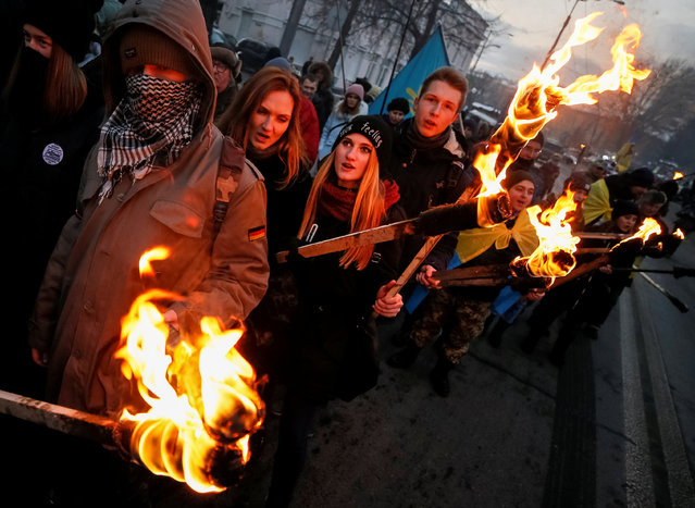 Activists and supporters of Ukrainian nationalist parties take part in a march with torches to honour several hundred students who died during a battle on January 29, 1918 while defending the Ukrainian capital from the Bolsheviks, in Kiev, Ukraine, January 29, 2017. (Photo by Gleb Garanich/Reuters)