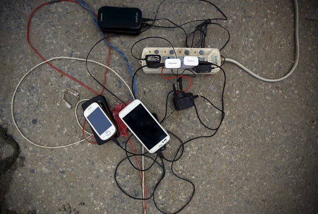 Cellphones pictured charging as a generator circulates power due to a power cut after an earthquake in Kathmandu, Nepal April 29, 2015. (Photo by Navesh Chitrakar/Reuters)