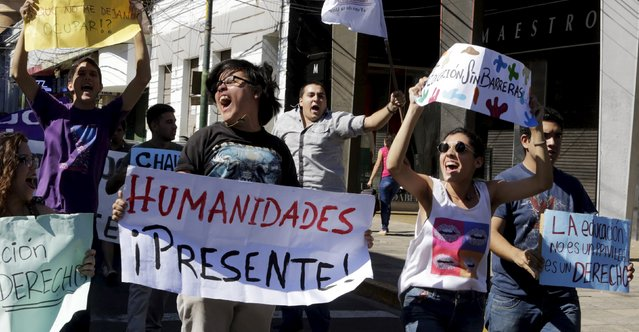 "People march during a rally to celebrate International Workers' Day in Asuncion May 1, 2015. The posters read: ""Present Humanities"" (L), ""Education is not a privilege but a right"" (R) and ""Education without barriers"" (C). (Photo by Jorge Adorno/Reuters)"