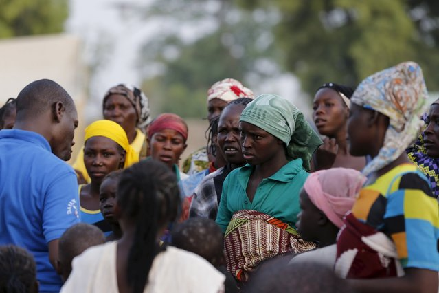 Women displaced by Boko Haram violence residing at the IDP camp yola, are briefed before other women and children rescued from Boko Haram in Sambisa forest by Nigeria Military arrive at the Internally displaced people's camp in Yola, Adamawa State, Nigeria May 2, 2015. (Photo by Afolabi Sotunde/Reuters)