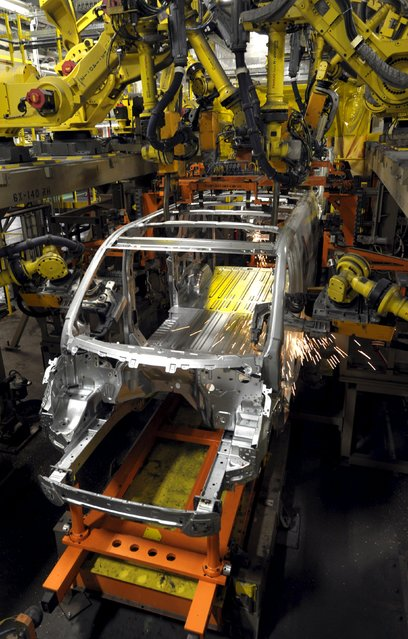 Robotic arms weld a Ford Transit Van being made at their Kansas City Assembly Plant where the new aluminum intensive Ford F-Series pickups are also built in Claycomo, Missouri May 5, 2015. (Photo by Dave Kaup/Reuters)