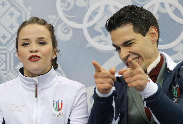 Anna Cappellini and Luca Lanotte of Italy gestures as they wait in the results area after competing in the ice dance free dance figure skating finals at the Iceberg Skating Palace during the 2014 Winter Olympics, Monday, February 17, 2014, in Sochi, Russia. (Photo by Vadim Ghirda/AP Photo)