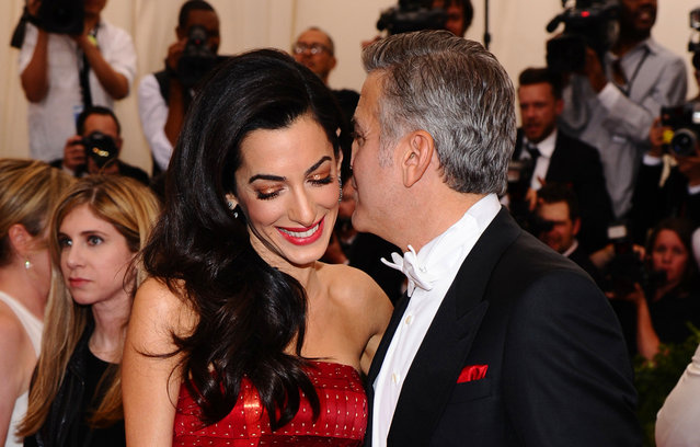 "Amal Clooney, left, and George Clooney arrive at The Metropolitan Museum of Art's Costume Institute benefit gala celebrating ""China: Through the Looking Glass"" on Monday, May 4, 2015, in New York. (Photo by Charles Sykes/Invision/AP Photo)"