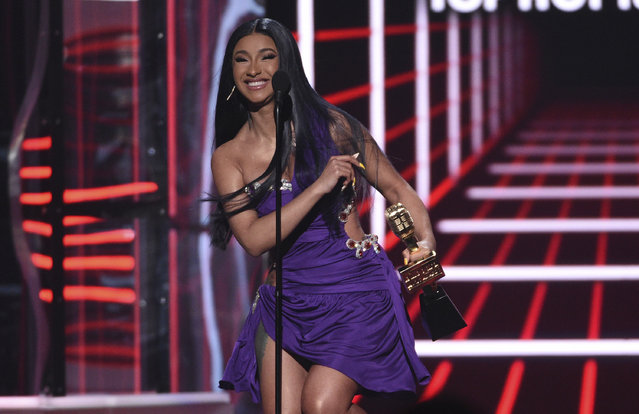 "Cardi B accept the award for top 100 song for ""Girls Like You"" at the Billboard Music Awards on Wednesday, May 1, 2019, at the MGM Grand Garden Arena in Las Vegas. (Photo by Chris Pizzello/Invision/AP Photo)"