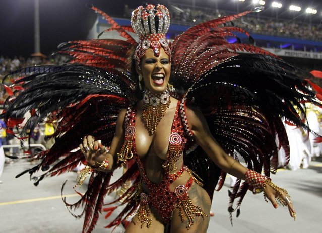 A reveller from the Perola Negra samba school takes part in the Special Group category of the annual Carnival parade in Sao Paulo's Sambadrome March 1, 2014. (Photo by Paulo Whitaker/Reuters)