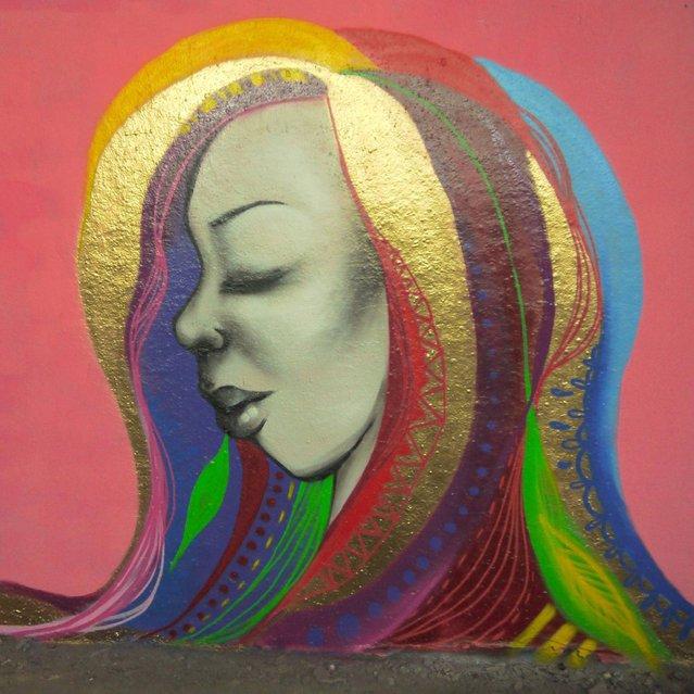 Street artist Miss Hazard adds her addition to Leake Street Tunnel. (Photo by Dez Mighty/Susan Mackey)