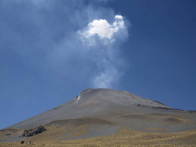 Every year hundreds of pilgrims head out from the towns of Santiago Xalintzintla, Tlamacas and San Nicolas de Los Ranchos in van and trucks to drive, then walk up the 17,886-foot (5,450-meter) volcano for their day long celebration. (Photo by Eduardo Verdugo/AP Photo)