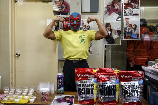 A man poses for a pictures as he sells High protein foods outside a Stardom female professional wrestling show at Korakuen Hall in Tokyo, Japan, December 23, 2015. (Photo by Thomas Peter/Reuters)