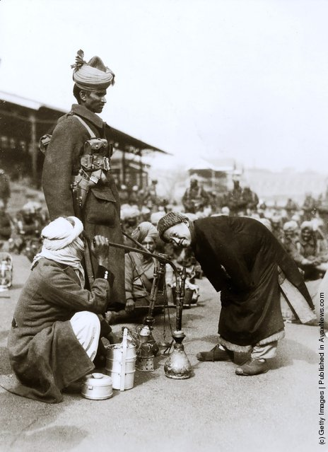 1927: A Chinese boy inspects pipes brought by Punjabi reinforcements to the defence of Shanghai