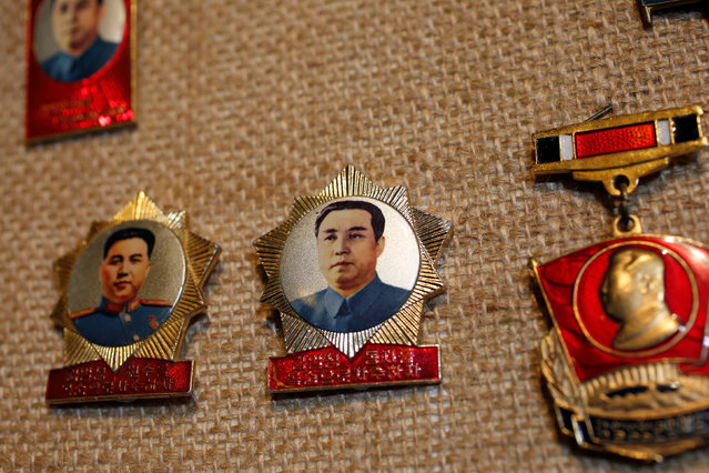 Badges featuring former North Korean leader Kim Il Sung are displayed in the glass case of Thomas Hui at his apartment in Hong Kong, China April 11, 2016. (Photo by Bobby Yip/Reuters)