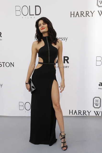 Model Isabeli Fontana poses for photographers upon arrival for the amfAR Cinema Against AIDS benefit at the Hotel du Cap-Eden-Roc, during the 68th Cannes international film festival, Cap d'Antibes, southern France, Thursday, May 21, 2015. (Photo by Thibault Camus/AP Photo)