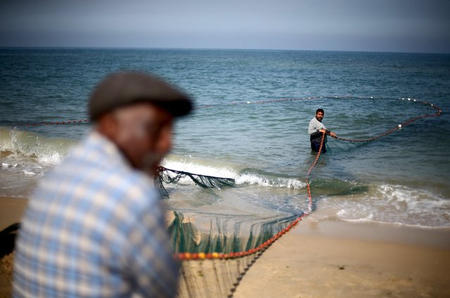 Palestinian fishermen use a net to catch fish on a beach in Gaza City April 3, 2016. Israel on Sunday extended the distance it permits Gaza fishermen to head out to sea along certain parts of the coastline of the enclave, which is run by the Islamist group Hamas. (Photo by Ibraheem Abu Mustafa/Reuters)