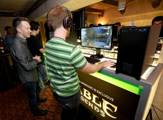 David Eckelberry, Game Director, Lionhead Studios, left, interacts with gamers as they get hands on with Fable Legends on Windows 10 at the Xbox-sponsored PC Gaming Show at E3 in Los Angeles on Tuesday, June 16, 2015. (Photo by Casey Rodgers/Invision for Microsoft/AP Images)