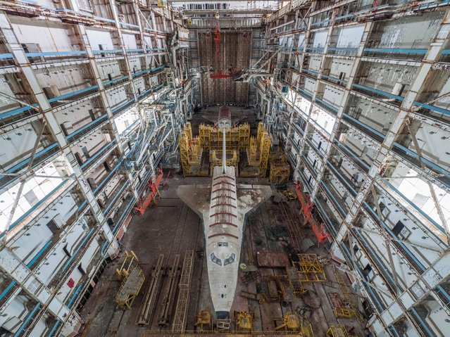 Ralph Mirebs, an urban explorer and photographer in Russia, has revealed extraordinary photos of Soviet space shuttle prototypes gathering dust in an abandoned hangar. The abandoned hangar is located at the Baikonur Cosmodrome in Kazakhstan, which is still in operation today (with the close of NASA's shuttle program, Russian Soyuz shuttles are the only way for astronauts to reach the International Space Station). The Buran prototype shuttles found by Mirebs, however, are from an earlier era – they are the last remnants of a space program that began in 1974 and was finally shuttered in 1993. The only operational Buran shuttle, Orbiter 1K1, completed one unmanned orbital flight before it was grounded. Unfortunately, this shuttle was destroyed in a hangar collapse in 2002. Many areas of the huge Baikonur Cosmodrome are still in business today, and that it is from here that the Soyuz rockets are launched, supplying the International Space Station in supplies and crew members. Mirebs' photos show this forgotten space program derelict and frozen in time. (Photo by Ralph Mirebs/Exclusivepix Media)