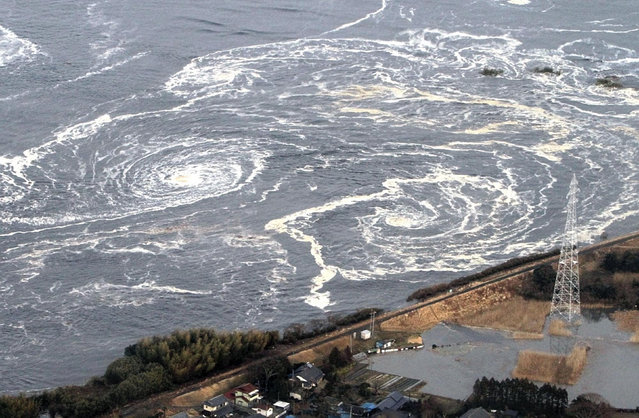 Whirlpools are seen following a tsunami and earthquake in Iwaki city, Fukushima Prefecture, March 11, 2011. (Photo by Reuters/Yomiuri)