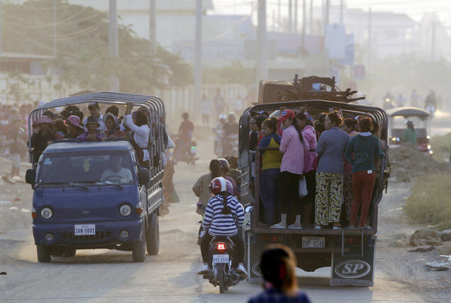 Workers ride trucks as daily transportation to work at factory near Trapang Anchanh village outside Phnom Penh, Cambodia, Wednesday, March. 15, 2017. (Photo by Heng Sinith/AP Photo)